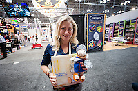 Aver Liberman Garrett holds her Maccabee on the Mantel plush and her book of the same name at the 112th American International Toy Fair in the Jacob Javits Convention center in New York on Monday, February 16, 2015.  The four day trade show with over 1000 exhibitors connects buyers and sellers and draws tens of thousands of attendees.  The toy industry generates over $84 billion worldwide and Toy Fair is the largest toy trade show in the Western Hemisphere. (© Richard B. Levine)