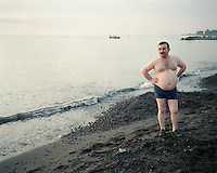 An Azeri man pauses on his morning walk along the Caspian Sea shore.
