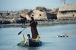 Marsh Arabs. Southern Iraq. Circa 1985. Children and mother in boats.