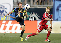 CHESTER, PA - AUGUST 12, 2012:  Brian Carroll (7) of the Philadelphia Union boots the ball away from  Chris Rolfe (18) of the Chicago Fire during an MLS match at PPL Park, in Chester, PA on August 12. Fire won 3-1.