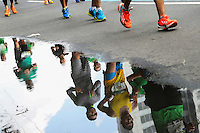 Athletes compete during the 32nd Mexico City International Marathon held in Mexico City, capital of Mexico, on Aug. 31, 2014. The Mexico City Marathon is a Boston Marathon qualifier. Photo by Miguel Angel Pantaleon/VIEWpress