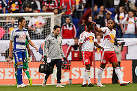 Thierry Henry (14) of the New York Red Bulls pats Bradley Wright-Phillips (99) opn the head as Wright-Phillips leaves the field with an injury during a Major League Soccer (MLS) match at Red Bull Arena in Harrison, NJ, on September 22, 2013.