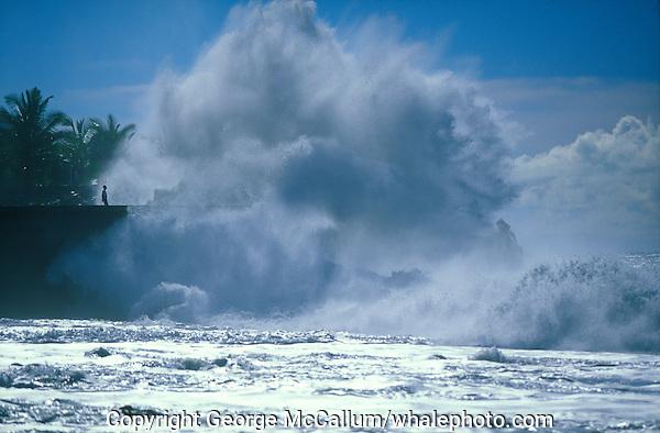Man watching  waves hitting sea wall day after a hurricane, Tazacorte,  La Palma, Canary Islands, Spain