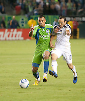 CARSON, CA – NOVEMBER 7:  Seattle Sounders defender Tyrone Marshall (14) and LA Galaxy midfielder Landon Donovan (10) during a soccer match at the Home Depot Center, November 7, 2010 in Carson, California. Final score LA Galaxy 2, Seattle Sounders 1.