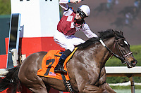 HOT SPRINGS, AR - March 18: Jockey Chris Landeros celebrates as he and Streamline #7 win the Azeri Stakes (Gr.2) at Oaklawn Park on March 18, 2017 in Hot Springs, AR. (Photo by Ciara Bowen/Eclipse Sportswire/Getty Images)