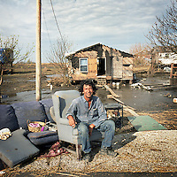 Alton Verdin outside his home in Pointe Aux Chene, a Native American community on the coast of south east Louisiana. His home suffered damage from hurricanes Gustav and Ike. He and his wife, who built the house themselves.