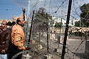 An Egyptian anti-government protester shouts appeals for Egyptian soldiers to join with the people across a barbed wire barricade outside the heavily guarded Orouba Presidential Palace February 11, 2011 in the Heliopolis district of Cairo, Egypt. Protesters marched Friday on a number of public buildings including the palace in an effort to spread their ongoing protests that are now in their 18th day. ..(Photo by Scott Nelson)