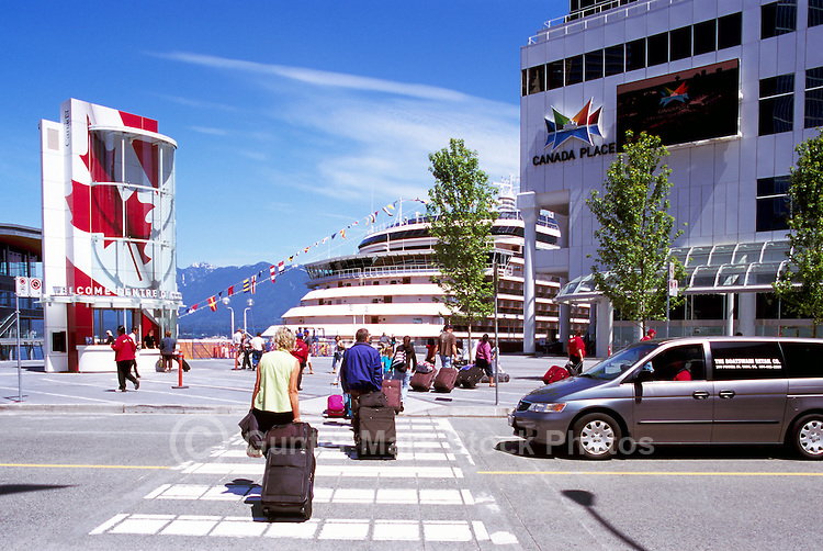 """Tourists arriving at """"Canada Place"""" Trade and Convention Centre and Cruise Ship Terminal and the New Tourist Welcome Centre and Information Booth, Vancouver, British Columbia, Canada"""