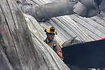 A firefighter in the middle of a collapsed building from a fire