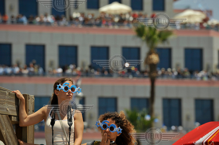 Women wearing novelty glasses during a military show celebrating the 60th anniversary of the State of Israel..
