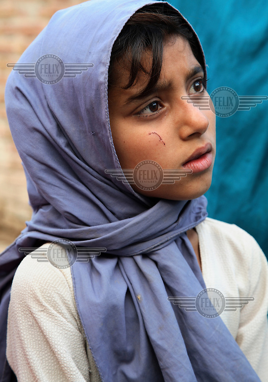 A girl listens at a women's meeting on contraception.