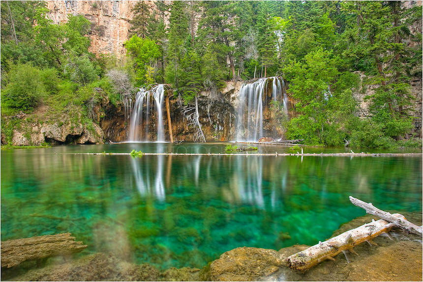 I awoke well before sunrise and hiked up to Hanging Lake (just outside of Glenwood Springs) mostly in the dark. I arrived at this amazing location about 30 minutes before sunrise and had this view all to myself. The water was perfectly calm and the trout were swimming in the clear water. This Colorado Image was nearly a 30 second exposure because it was still pretty dark. I've heard it gets crowded here, but I've never been here in the afternoon. I can tell you the mornings are wonderful and provide solitude.