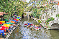 There is nothing that says San Antonio like the River Walk in downtown.  The River is a great place to visit there are restaurants, hotel, shopping, boat rides, and mile of area to walk along the river. You can see the colorful umbrells from this shoreline dinning at one of the oldest restaurants on the river.
