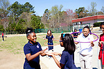 Serina Yenglee, 10, and Ra'Chel Young, 9, clap hands as Hannah Wallace (center), 9, hula hoops outside at Kennesaw Charter School in Kennesaw, Georgia, April 1, 2010. The 440 student school, which used to be managed by Imagine Schools, is now self-managed.