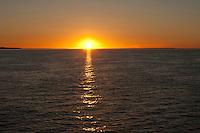 Sunset over the ocean where Kangaroo Island makes the western horizon, South Australia.