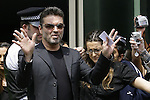 British Musician George Michael leaves Brent Magistrates Court in London June 7, 2007. Michael was given 100 hours community service and banned from driving for two years after being caught at the wheel of his car under the influence of drugs. REUTERS/James Boardman (BRITAIN)
