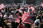 Huddled together for warmth, people pack the National Mall to watch the swearing-in of President-elect Barack Obama and Vice-President-elect Joe Biden. Washington, D.C., January 20, 2009.