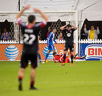Chris Pontius (13) of D.C. United reacts after missing a chance on an open net during a Major League Soccer game at RFK Stadium in Washington, DC. D.C. United tied the Philadelphia Union, 1-1.