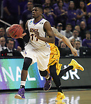 Northern Iowa's Wes Washpun (11) drives past Wyoming's Josh adams (14) during their  2015 NCAA Division I Men's Basketball Championship March 20, 2015 at the Key Arena in Seattle, Washington.   Northern Iowa beat Wyoming 71 to 54.   ©2015.  Jim Bryant Photo. All Rights Reserved.