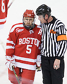 David Warsofsky (BU - 5) talks to Jack Millea at the end of the first period. - The Boston College Eagles defeated the visiting Boston University Terriers 5-2 on Saturday, December 4, 2010, at Conte Forum in Chestnut Hill, Massachusetts.
