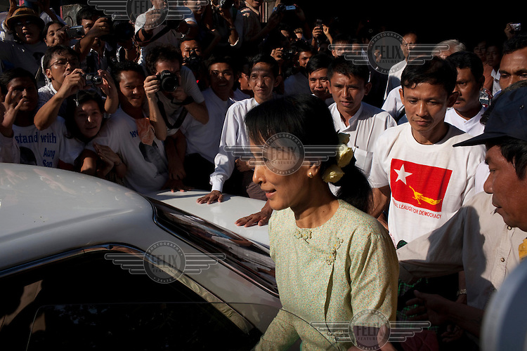 Aung San Suu Kyi gets into a car outside the National League of Democracy party headquarters the day after her release from house arrest in Rangoon. From 1990 until her release on 13 November 2010, Aung San Suu Kyi had spent almost 15 of the 21 years under house arrest.