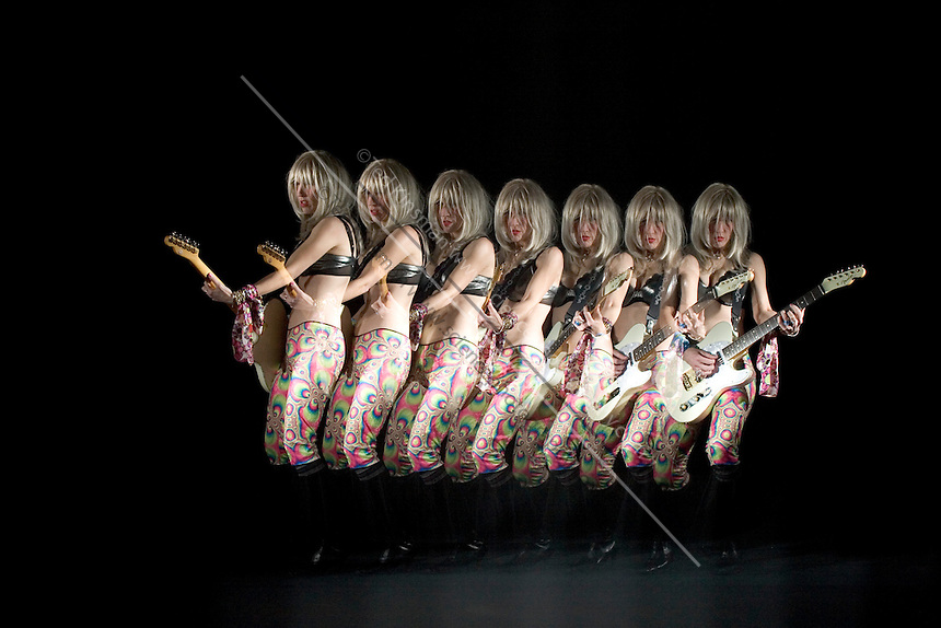 April Laragy, the lead singer of The Atomic Swindlers shows off her guitar moves.  A special stroboscopic camera records the motion.  The record of the motion can be analyzed to show both the timing and range of the motion.  This type of image is very important in the science of biomechanics.
