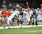 Ole Miss' Randall Mackey (1) vs. Tulane's Lorenzo Doss (6) in the first half at the Mercedes-Benz Superdone in New Orleans, La. on Saturday, September 22, 2012. Ole Miss won 39-0...