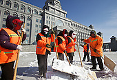 Street-sweepers clear snow in front of the government administration building of Manzhouli, a Chinese boomtown on the China-Russia border. The town has grown from a smaller village just two decades ago to a town of 200,000 people, and its economy is driven by trade with Russia across the border.