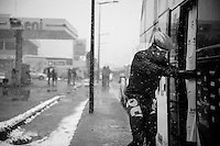 Milan - San Remo 2013: the iced edition.<br /> J&uuml;rgen Roelandts (BEL) is struggling simply getting on the teambus