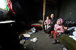 Vita Stankovic and his 3-year old daughter Caka and 5-year old daughter Rada inside their meager home in a Roma settlement in Belgrade, Serbia, in early 2012. The family had been told it would be evicted by city officials in March 2012 to make way for new high-rise office buildings.  In April 2012, the Serbian Orthodox family was forcibly evicted from the city center and given a metal shipping container in Makis, at the edge of Belgrade, where they could live. After several weeks, they were evicted from the shipping container because of Stankovic's repeated fights with his neighbors, and at the end of 2012 lived in an informal Roma squatter settlement in nearby Palilula. In 2009, they had been evicted from another settlement in Belgrade..