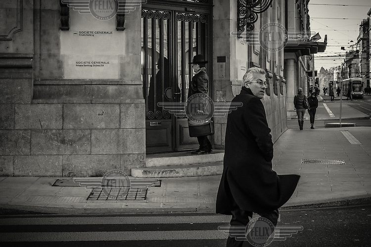 A man enters an office of Societe Generale Private Bank.