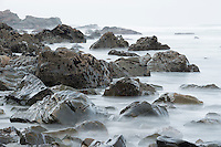 Moody, rugged coastline with rock formations near Rapahoe near Greymouth, West Coast, New Zealand