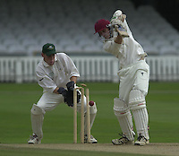 Photo Peter Spurrier.01/09/2002.Village Cricket Final - Lords.Elvaston C.C. vs Shipton-Under-Wychwood C.C..Shipton wicket keeper Shane Duff, look's on as Elevaston's Lee Archer is bowled by Phil Garner