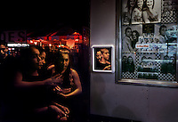 We do all our business at fairs, says Steve Bennett, owner of Photos Now. It's very popular. People like to take home momentos. A booth-side mirror captures folks waiting for their black and white portraits at the L.A. County Fair in California.