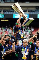 Gerardo Torrado (6) of Mexico (MEX) holds the Gold Cup trophy aloft during post-game celebrations. Mexico (MEX) defeated the United States (USA) 5-0 during the finals of the CONCACAF Gold Cup at Giants Stadium in East Rutherford, NJ, on July 26, 2009.