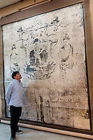 Benrido photographer Katsuhiko Honjo looks at a collotype of a mural from Horyu-ji temple in Nara. Benrido collotype atelier, Kyoto, Japan, October 9, 2015. The Benrido collotype atelier in Kyoto was founded in 1887 and is the only full-scale commercial collotype atelier in the world. Collotype is a historic photographic printing process that makes use of plates coated in gelatine. It produces prints of unrivalled quality.