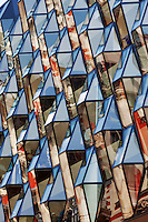 A faceted glass diamond shaped fa&ccedil;ade gives a modern face to an old 1960s building. Oxford street, London. <br />