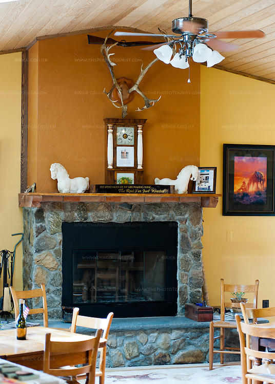 A stone fireplace with raised hearth makes a natural center for the seating area in the tasting room at Desert Rose Ranch and Winery.