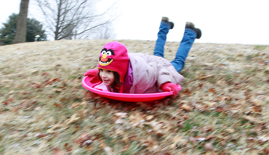 Ava Shurtleff goes sledding after a lite snow in Albemarle County, VA. Photo/Andrew Shurtleff