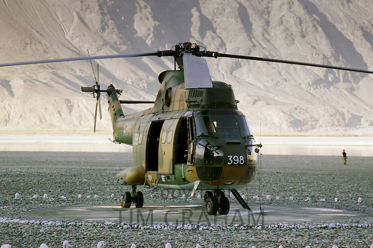 Military Helicopter on landing pad in Hunza region of Karokoram Mountains, Pakistan