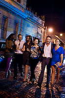 Crowds descend onto via Monte Testaccio, Testaccio's popular nightclub strip, Rome, Italy