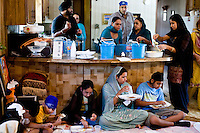 The congregation of Austin Gurdwara shares a communal meal called Langar in the trailer that once housed their sanctuary.  The congregation began worshiping in 2003 in the mobile home on property they purchased in far west Austin.  In 2005, the congregation obtained the necessary permits to begin construction of a new temple and faced no opposition until John and Leslie Bollier moved into the neighborhood in 2008 and filed suit claiming the temple violated the subdivision's restrictions on commercial building.<br />
