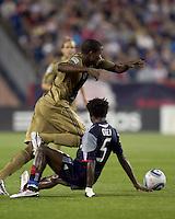 New England Revolution defender Emmanuel Osei (5) tackles Philadelphia Union forward Danny Mwanga (10). The Philadelphia Union defeated New England Revolution, 2-1, at Gillette Stadium on August 28, 2010.