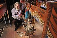 Mimmo Cuticchio in the backstage of his puppet theatre..Mimmo Cuticchio nel suo teatrino a Palermo con i suoi pupi.