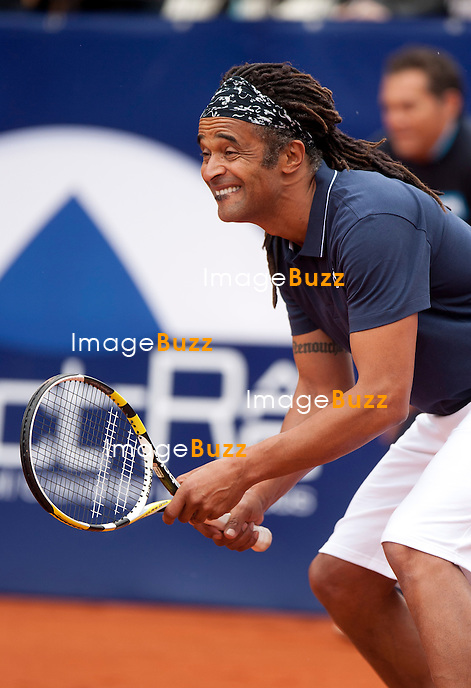 Yannick Noah making jokes with the public an playing funny during an exhibition tennis match with Iranian tennis player Mansour Bahrami at the 6th Edition Legends Cup in Namur, Belgium.