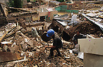 Central America, Honduras, Tegucigalpa. Reclaiming materials. Devastation in the aftermath of Hurricane Mitch. High winds and flooding. Infrastructure destroyed.