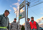 Nov. 3, 2012 - Merrick, New York, U.S. - U.S. Army National Guard members from Syracuse, NY, are at the Merrick Hess gas station, one of the Long Island gas stations open the Saturday after Hurricane Sandy battered this south shore area, to help Nassau County police maintain order in the long lines of people waiting their turn at the pumps. The Freeport Armory in the next town was supposed to have free gas, up to 10 gallons for each car, this day, but people who showed up there were turned away. About 500,000 of the 1.2 million Long Islanders who lost power still didn't have it, and the area continued to suffer from severe damage from floods and wind.