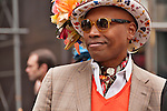 A man wears colorful top hat covered with flowers and butterflies to the Easter Day Parade in New York City on Fifth Avenue