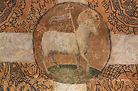 Fresco medallion of Agnus Dei or the Lamb of God, under the funerary monument of Ferry de Beauvoir, died 1473, Catholic prelate and 64th bishop of Amiens 1457-73, in the South side of the choir, at the Basilique Cathedrale Notre-Dame d'Amiens or Cathedral Basilica of Our Lady of Amiens, built 1220-70 in Gothic style, Amiens, Picardy, France. Amiens Cathedral was listed as a UNESCO World Heritage Site in 1981. Picture by Manuel Cohen