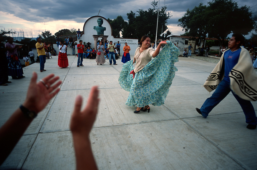 Members of a young dance troupe take to the town plaza to practice for the local Guelaguetza dance festival in Cuilapán, Mexico.